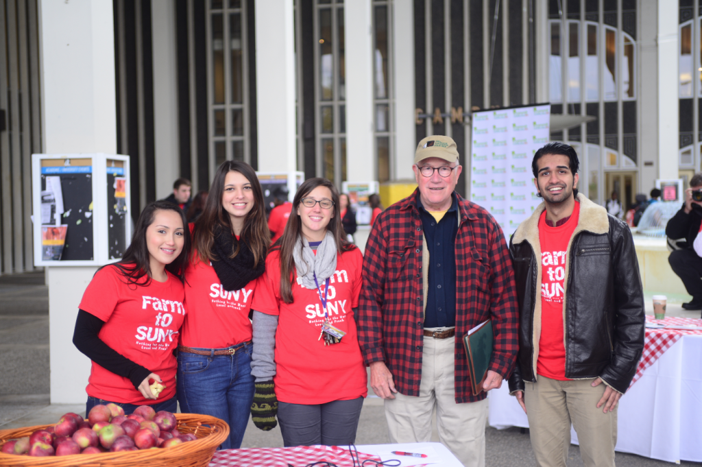 Apple farmer Pete TenEyck, Indian Ladder Farms, at the Campus Crunch with Farm to SUNY interns at University at Albany. Credit: Dietrich Gehring